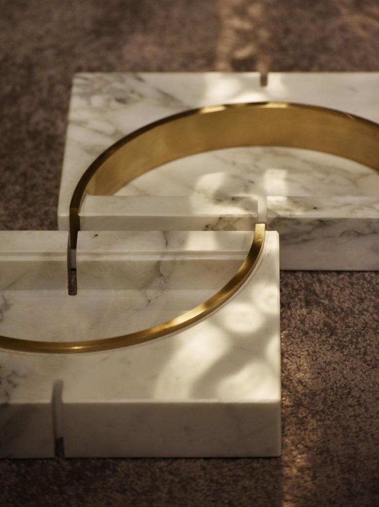 Aureo is the name of this ashtrays or vase in marble and brass detail handmade design in Italy designed by Andrea Bonini. Scolptural art piece in white carrara marble (avviable in other marbles) with a brass brushed finish metal, can be used for