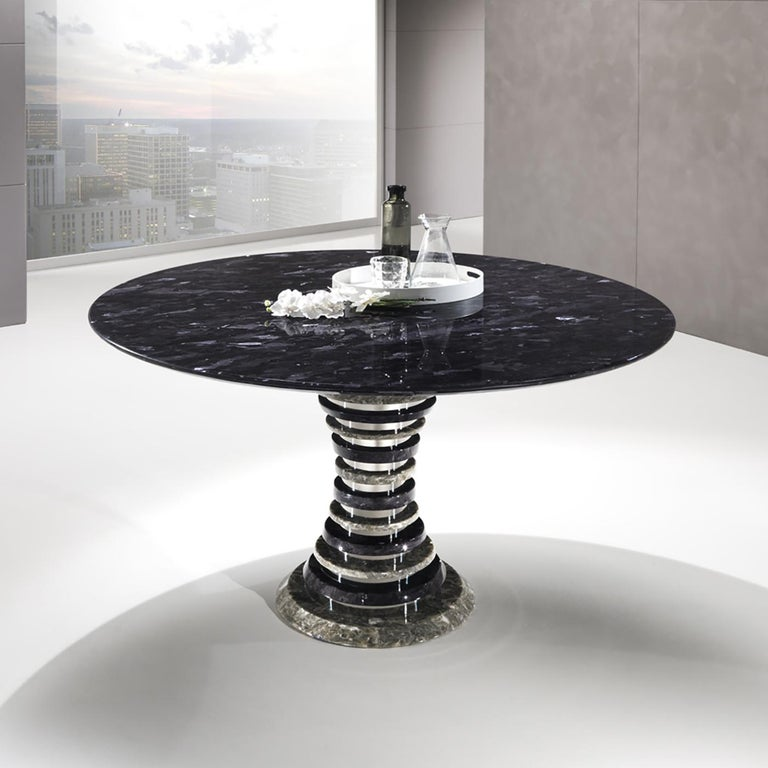 This elegant round dining table belongs to the distinctive Auriga Collection handcrafted of Crystal Stone®, a crystalline alabaster unique to the Ballarini family's exclusive quarry and sculpting atelier in the Romagna region of Italy. This table
