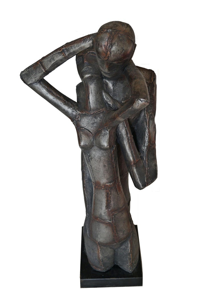 This is a very unusual Austin Productions Brutalist sculpture. Lovers / nude man and woman. Almost looks like Frankenstein and Frankenstein's Bride, by the shape of her hair. A beautiful piece. Uncertain of what this is made of, but weighs approx