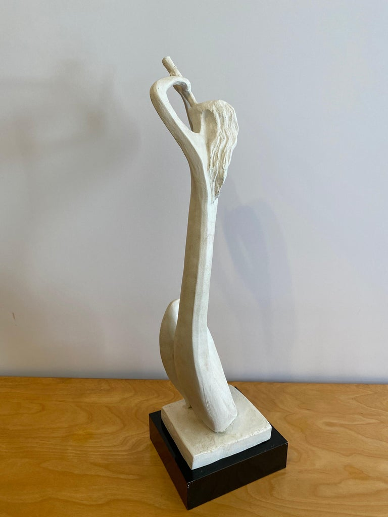 Austin Productions horn blower in white. Abstract figure with up-reaching hands! Signed bottom dated 1980. Sits on a black wood base.