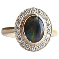 Australian Black Opal 1.188 Carat Ring, 14 Karat Gold Halo Ring