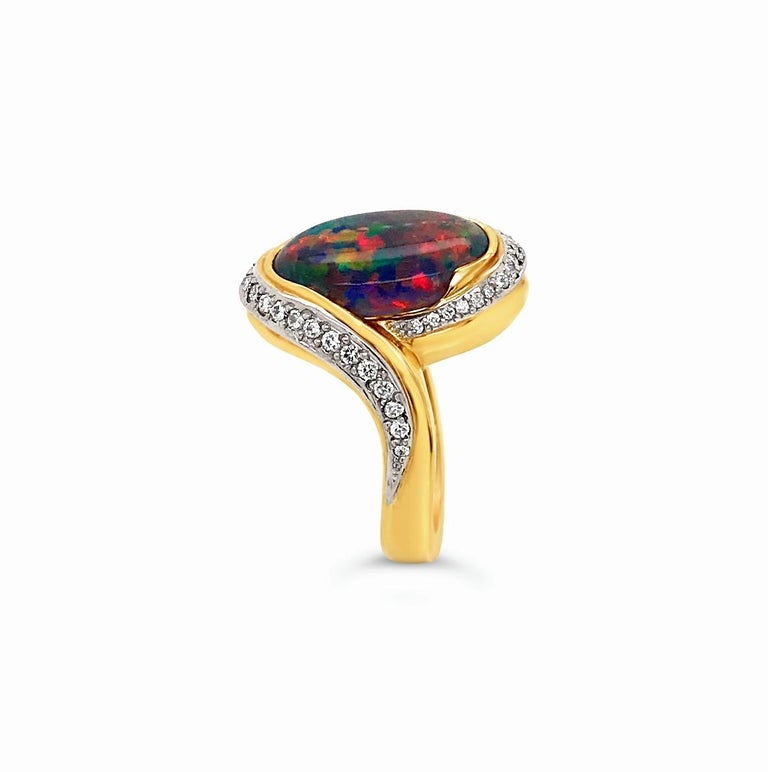 Shakespeare would have loved our vivid red Othello with its passionate flashes of blue, purple, gold and touches of orange. This enthralling and delightful black opal hails from Lightning Ridge in New South Wales, Australia, the centre for
