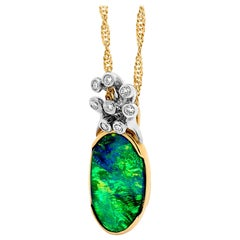 Australian Black Opal and Diamond Pendant in 18 Karat White and Yellow Gold