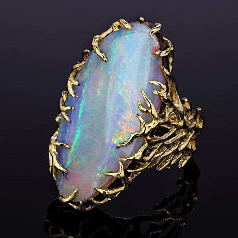 Natural boulder opal 14k yellow gold ring   opal origin - Australia  opal measurements - 0.16 х 0.59 х 1.18 in / 4 х 15 х 30 mm  stone weight - 16.50 carat  ring weight - 10.44 grams  ring size - 6.5 US