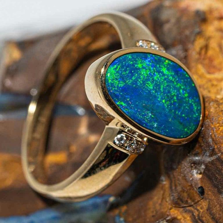Oval Cut Australian Opal Diamond Ring 14 Karat Yellow Gold For Sale