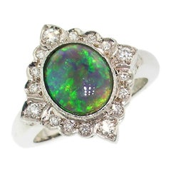Australian Opal in 18 Karat Ring, Handmade and Hand-Engraved in Italy