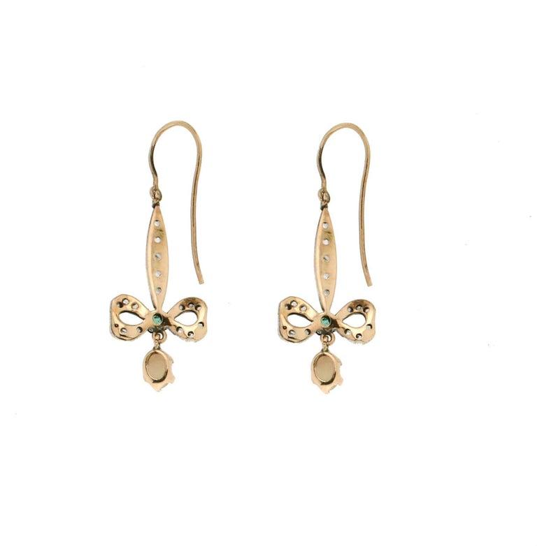 Australian Opal,9 Karat Yellow Gold And Silver,Emeralds,Diamonds,Drop Earrings  Earrings weight 4.20 grams Diamonds weight 0.10 karat Emeralds weight 0.15 karat