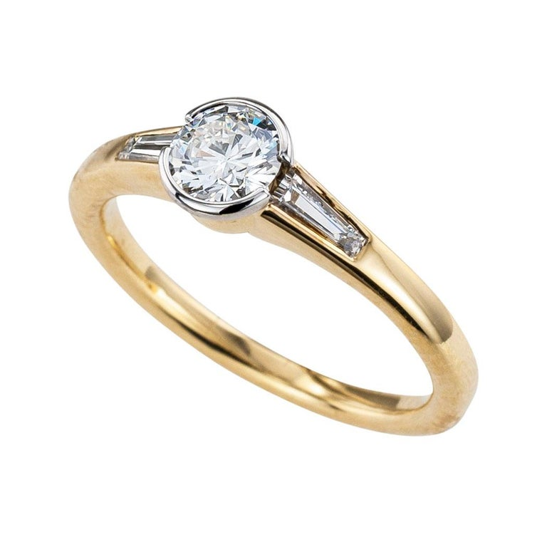 Austrian 0.42 carat round diamond and yellow gold engagement ring.  Love it because it caught your eye, and we are here to connect you with beautiful and affordable jewelry.  Simple and concise information you want to know is listed below.  Contact