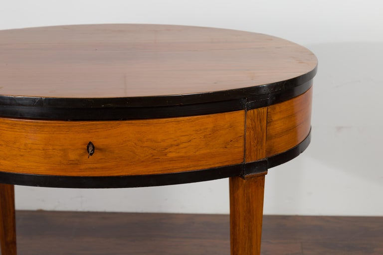 Austrian 1840s Biedermeier Oval Top Table with Drawer and Ebonized Accents In Good Condition For Sale In Atlanta, GA