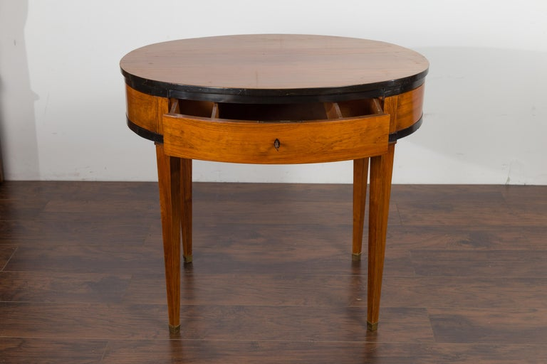 19th Century Austrian 1840s Biedermeier Oval Top Table with Drawer and Ebonized Accents For Sale