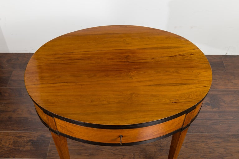 Brass Austrian 1840s Biedermeier Oval Top Table with Drawer and Ebonized Accents For Sale