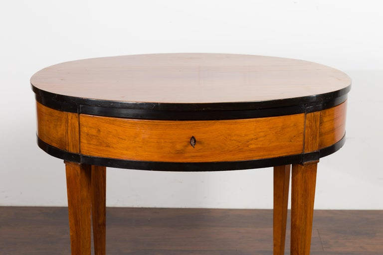 Austrian 1840s Biedermeier Oval Top Table with Drawer and Ebonized Accents For Sale 2