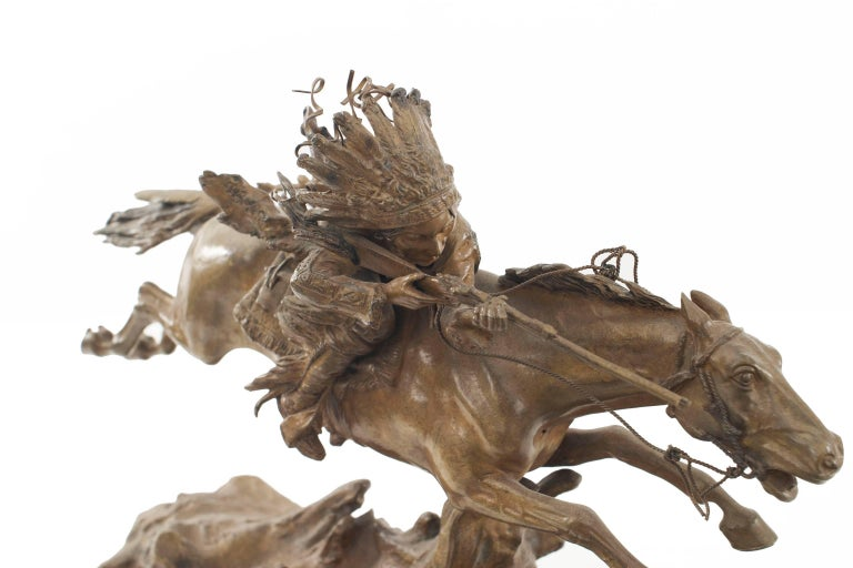 Austrian (19th-20th century) bronze figure of a Native American with rifle riding on horse (signed C. KAUBA).