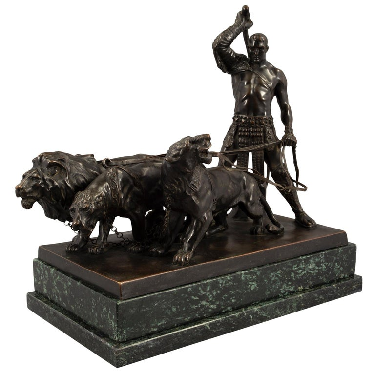 A very handsome Austrian 19th century patinated bronze and Vert de Patricia marble statue of a gladiator with a lion, a lioness and a panther, signed and stamped F. Gornik. The statue is raised by a think rectangular Vert de Patricia marble stepped