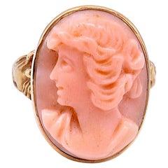Art Nouveau 14 Karat Angel Skin Coral Cameo Ring with Carved Shoulders, C1910