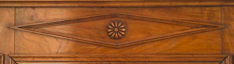 Austrian Biedermeier style fruitwood vertical wall mirror with panelled sides and a diamond design motif on top.