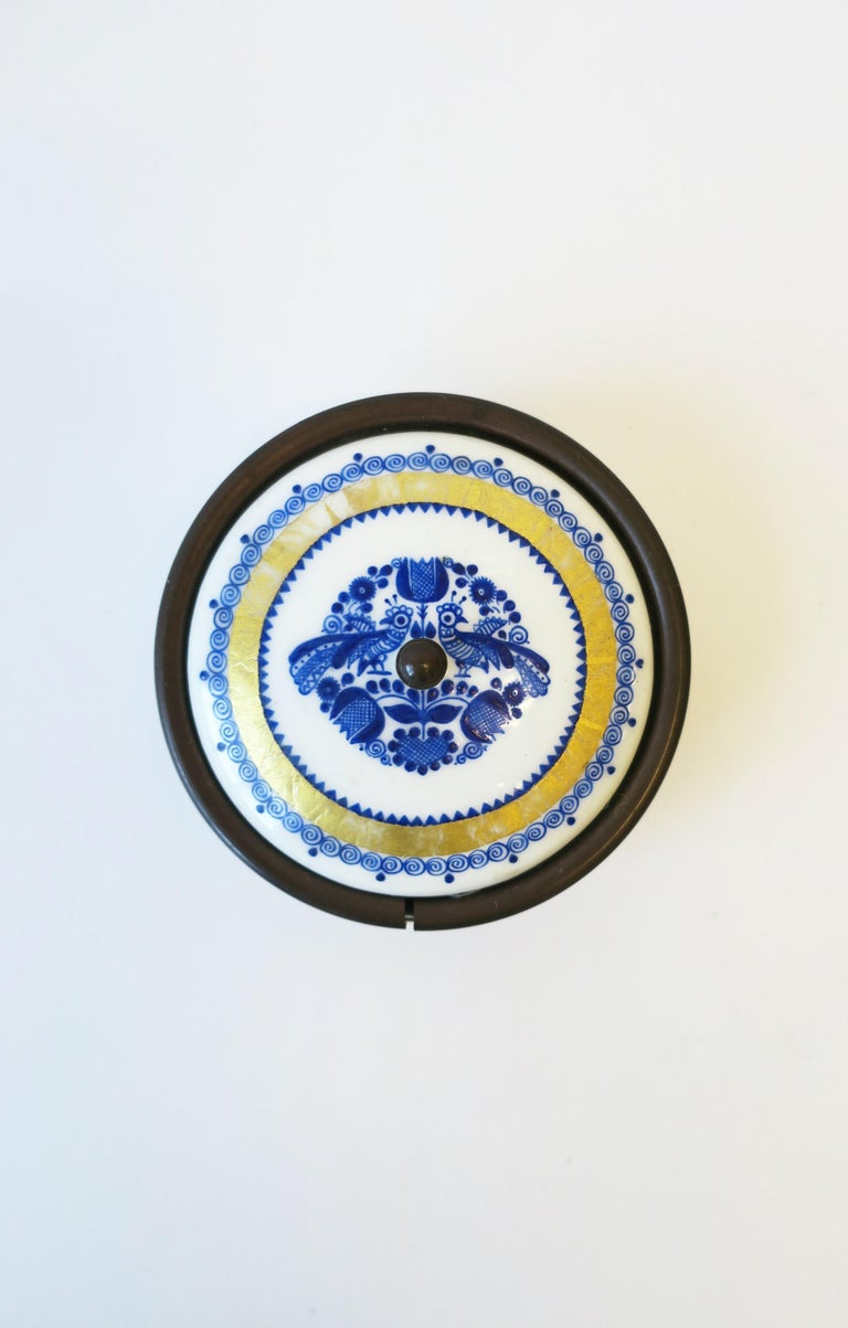 A beautiful Austrian blue, white, and gold porcelain enamel box, jewelry dish, or small vide-poche (catch-all) with lid, circa mid-20th century, Austria. Box has detailed design of peacock birds, flowers, leaves, and swirls. Marked