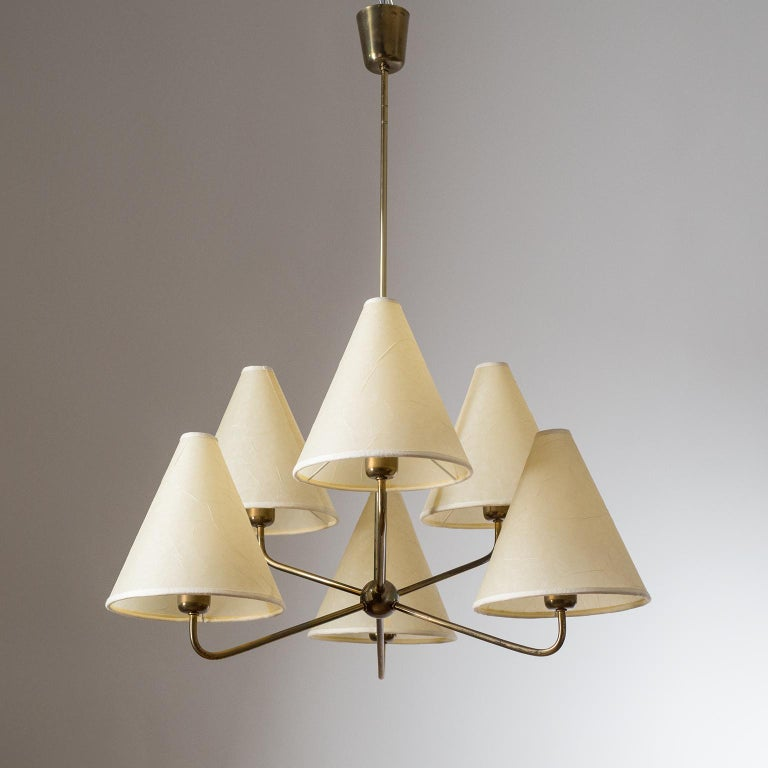 Rare Austrian brass Sputnik chandelier with parchment paper shades, attributed to J.T. Kalmar from the 1950s. Very nice condition with a dark patina on the brass and original brass and ceramic E27 sockets.