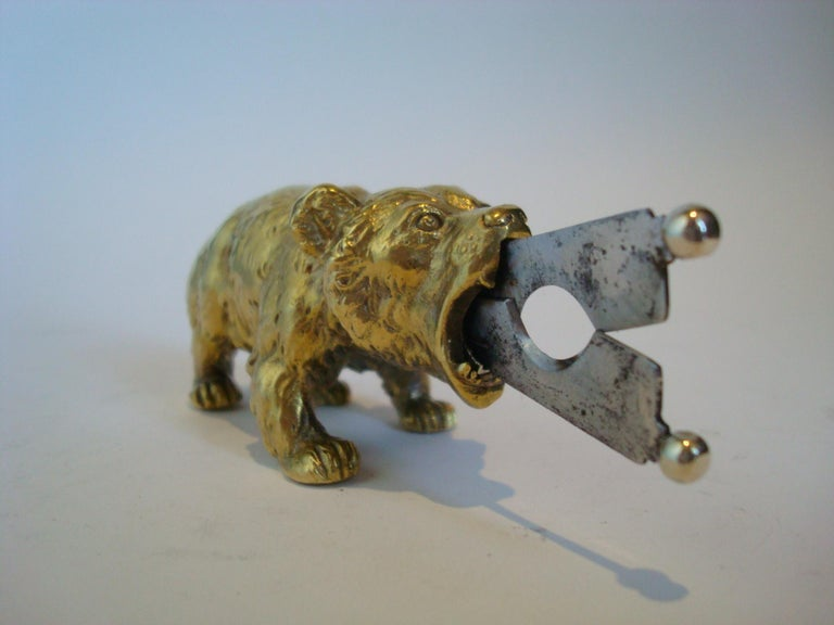 A solid bronze bear sculpture desktop cigar cutter manufactured in Austria. The scissor action steel blades are remove-able form the mouth of the roaring bear. Excellent condition. Solid Bronze Retractible hidden cigar cutting steel blades. Perfect