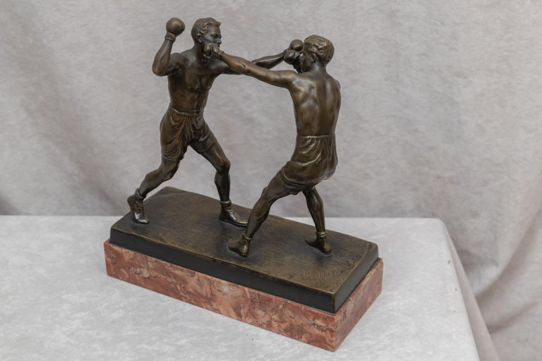 We are always on the lookout for sports subject matter in our quest for antique bronzes. Boxing is right up at the top of our list. This high action, well modeled example of 2 boxers engaged in their sport is exactly the kind of work we are looking