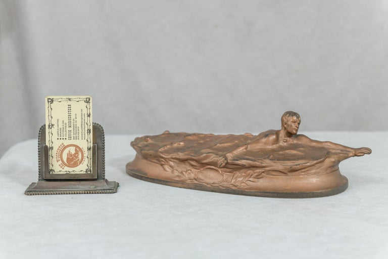 This very unusual bronze depicts a swimmer showing off his form. Artist signed