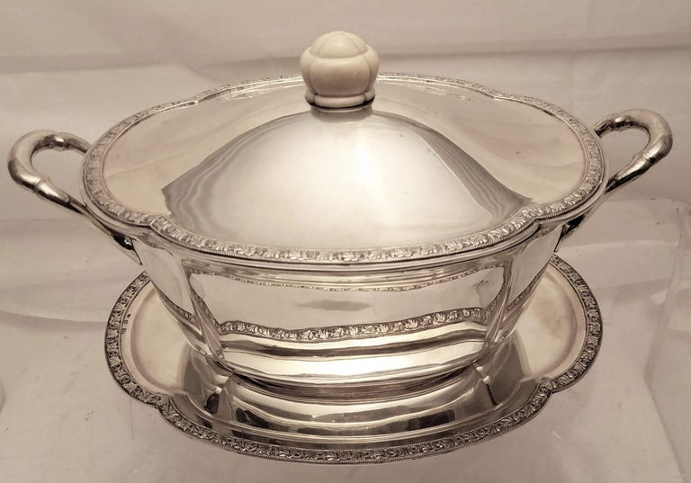 Continental 0.800 silver Austrian tureen with a matching under tray in Jugendstil style, insert in center of tray to fit the tureen. Designed with leaves around the boarder of tray and tureen with intricate beading aligning the leaves, handles on