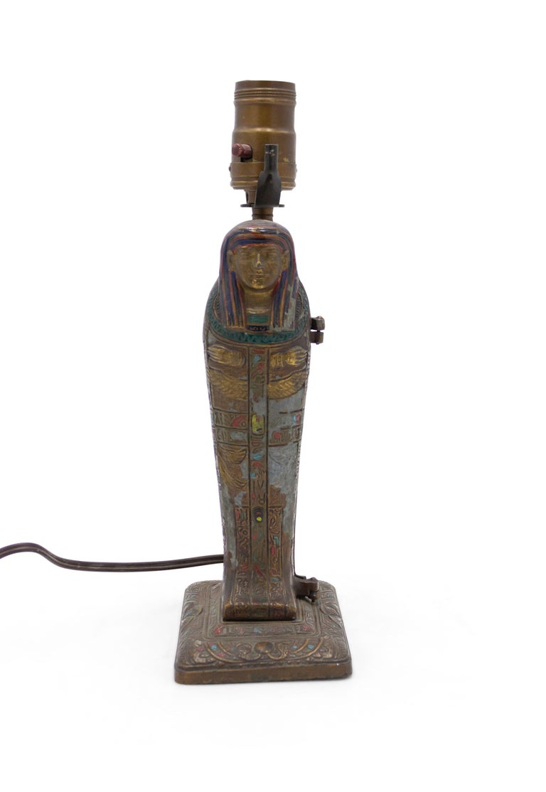 Austrian Egyptian revival style metamorphic cold-painted bronze sarcophagus shaped table lamp in the style of Franz Bergman with a bronze doré female figure inside base. (Attributed to LOUIS V. ARONSON circa 1923).