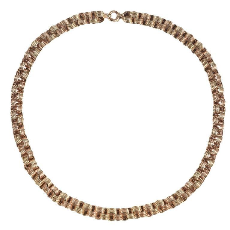 The necklace of multiple rope-link design to a round shape clasp.  Mounted in 14Kt yellow gold.   Length 45.5 cm   Weight 27.3 gr
