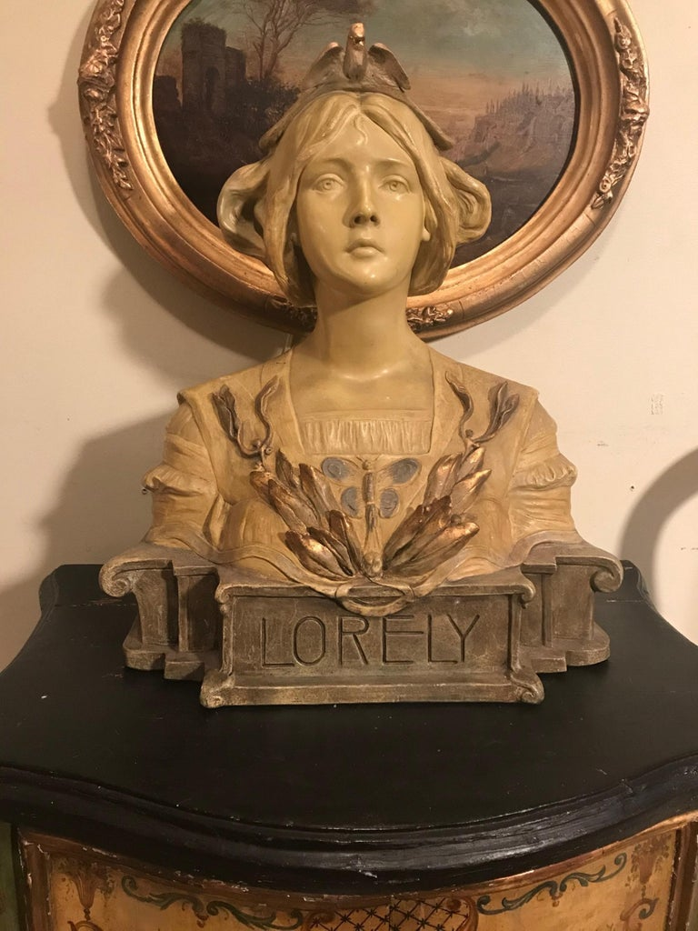 """Antique Austrian Goldscheider terracotta bust of Lorely, circa 1900  This is a superb and large Art Nouveau polychrome painted terracotta bust of the German river maiden, 'Lorely"""" (Lorelei). This rare bust was created and modeled by the sculptor,"""