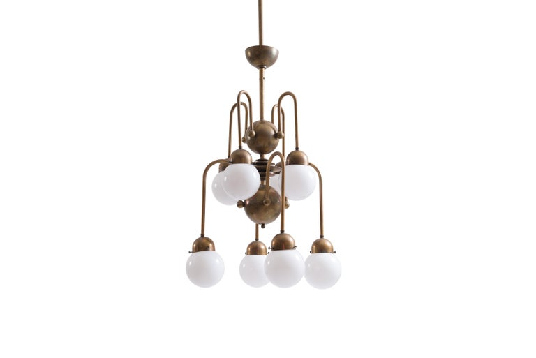 A beautiful very elaborate chandelier, pictured in patinated brass.