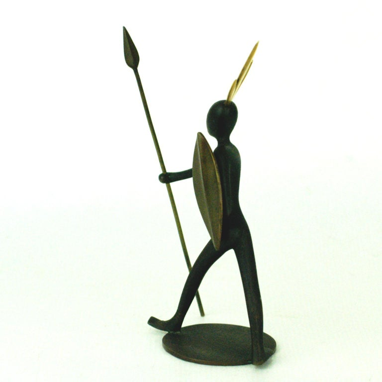 Amazing iconic African warrior sculpture designed by Karl Hagenauer and manufactured by Werkstätte Hagenauer Wien during the 1950s. It is made of black patinated bronze and brass, marked on the underside Hagenauer Wien, WHW, Made in Austria,