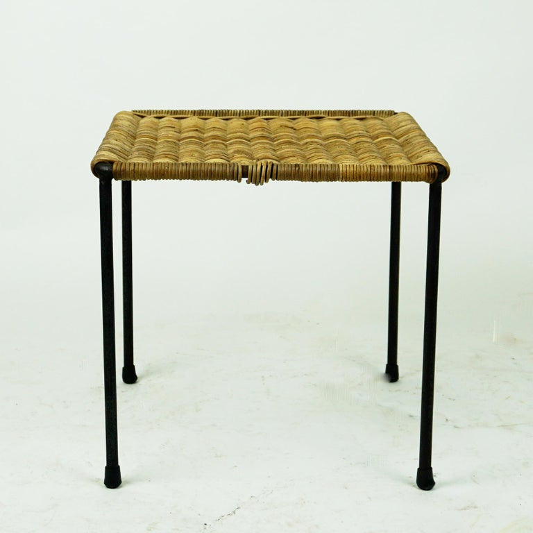 A charming small square sized table or stool designed and made by Carl Auböck II, Vienna, Austria, circa 1950 in beautiful original condition. It´s frame is made from slender steel which has been lacquered in black and it has rubber shoes at the
