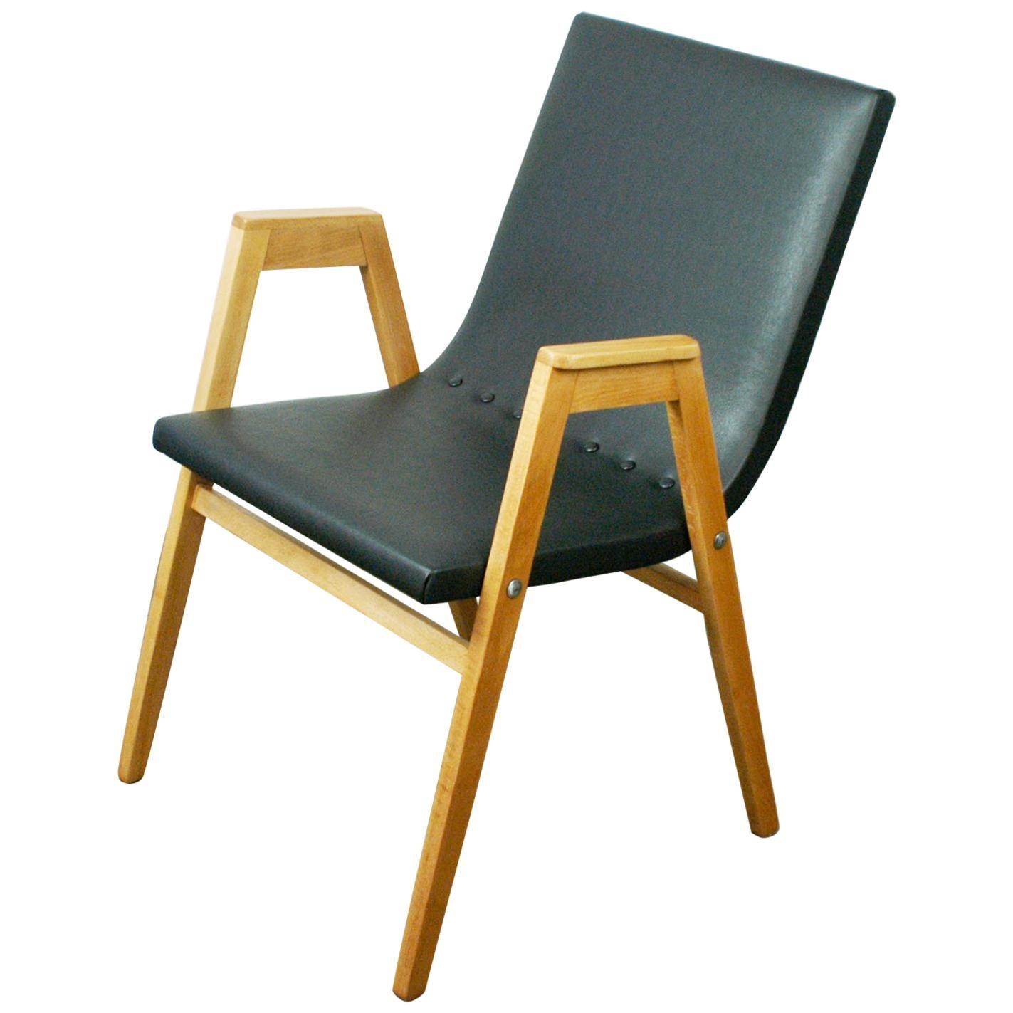 Austrian Midcentury Beech Stacking Armchair by Roland Rainer