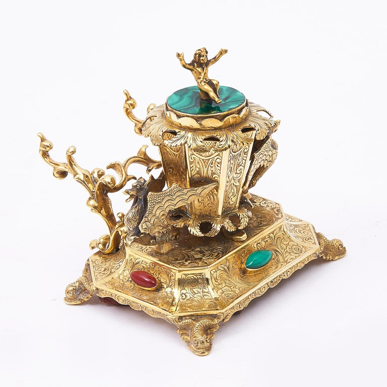 Ormolu desk set ornamented with hardstones, comprising of an inkwell with penholder, candlestick, brush pot and shallow dish, possibly for blotting powder, circa 1850. Each item adorned with decorative foliate engravings and with two mounted