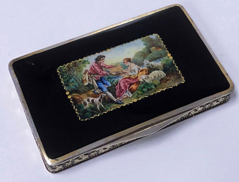 1920's Austrian Sterling Silver hand painted enamel Box or Snuff Box with romantic pastoral scene, rosette foliage vermeil sides, engine turned base and gilded interior. Austrian hallmarks and also stamped Sterling Silver and number 946 on interior.