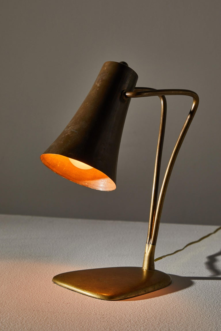 Table lamp designed and manufactured in Austria circa 1940s. Bronze plated brass shade, brass base. Shade adjust up/down. Original cord with US plug. Takes one E26 40w maximum Edison bulb.