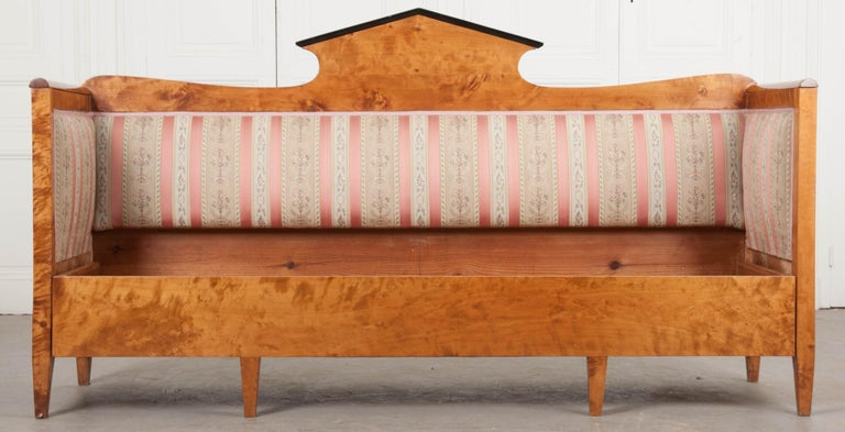 """A fabulous Biedermeier style settee from 19th century Bavaria. The settee is made from exceptionally beautiful, solid maple. Some areas have a striped appearance to the grain. This is known as """"tigering"""". The sofa's back has a central pointed"""