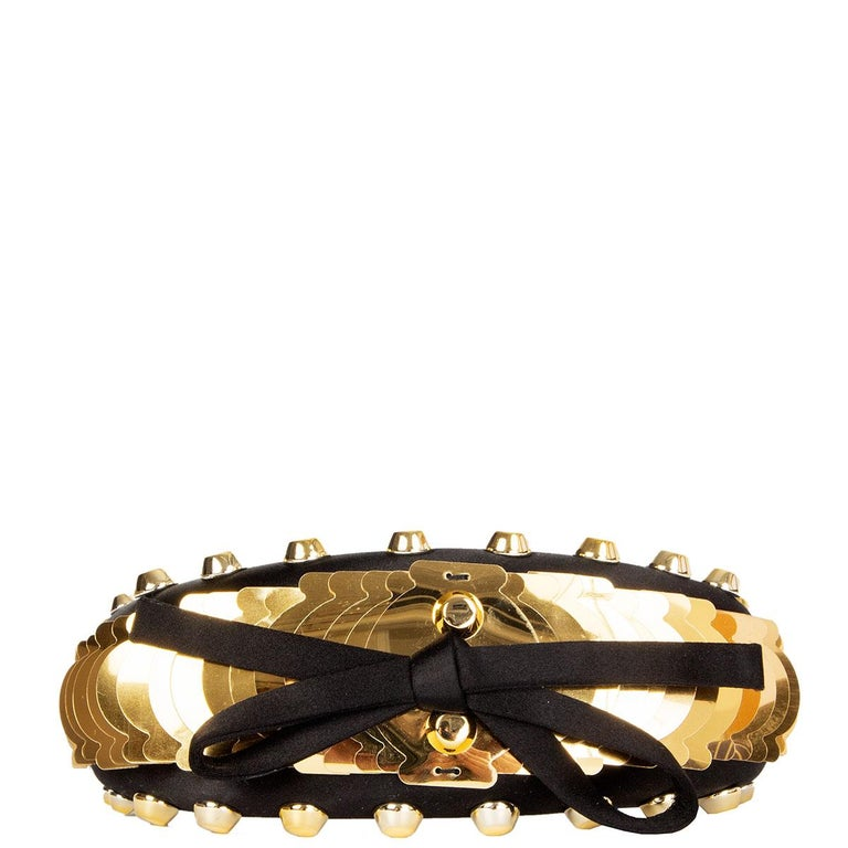 100% authentic Prada studded and embellished gold-tone acetate headband in black satin with bow detail. Has been worn and is in excellent condition.   All our listings include only the listed item unless otherwise specified in the description above.