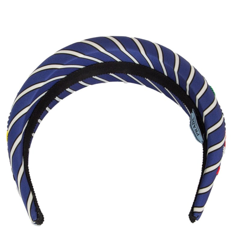 100% authentic Prada striped satin headband in blue and white with red, rose, green and yellow flower embroidery. Has been worn and is in excellent condition.   All our listings include only the listed item unless otherwise specified in the