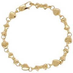 Auth Tiffany & Co. 18K Yellow Gold Heart and Bow Tie Bracelet