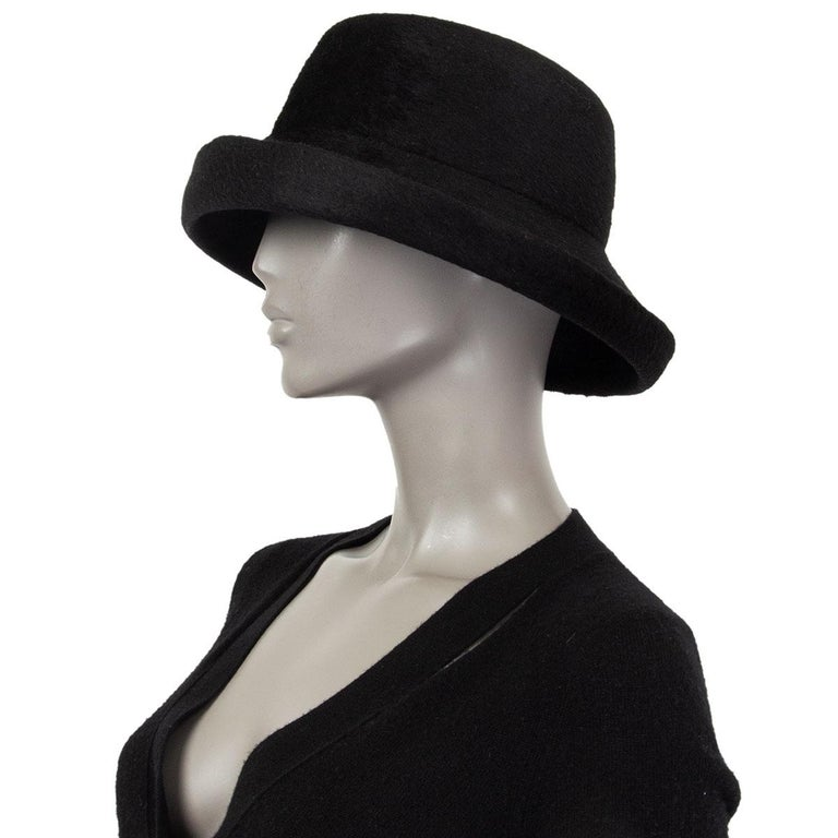 100% authentic Yohji Yamamoto hat in black rabbit fur with asymmetrical brim. Has been worn and is in excellent condition.  Inside Circumference 57.7cm (22.5in)  All our listings include only the listed item unless otherwise specified in the