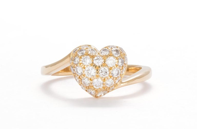 We are pleased to offer this Authentic Cartier 18K Yellow Gold Diamond Pave Heart Ring. Elite elegance from house of Cartier, this gorgeous ring is crafted from solid 18k yellow gold with a fine polished finish and boast a lovely diamond pave heart