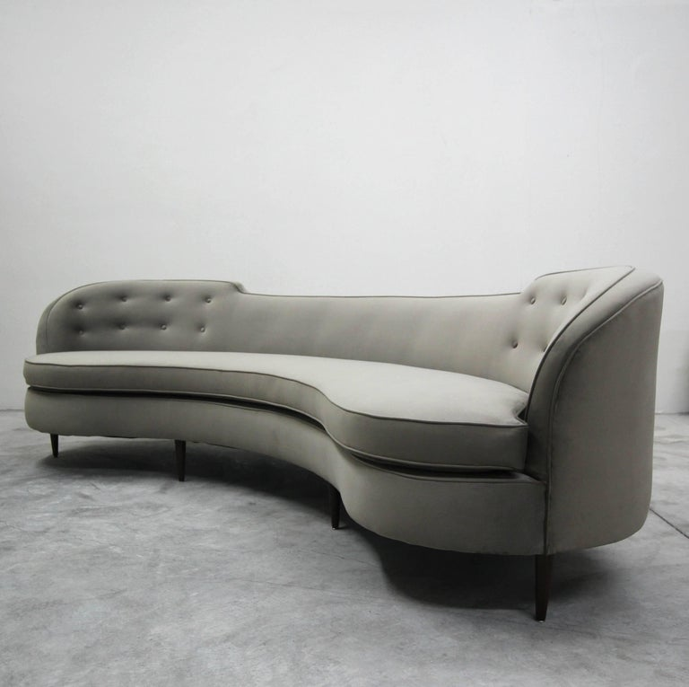 A rare classic to behold in this stunning vintage Edward Wormley for Dunbar sofa. Why settle for a modern replica when you can have the quality and authenticity of the real deal. The rounded lines of this gorgeous sofa combined with its large size