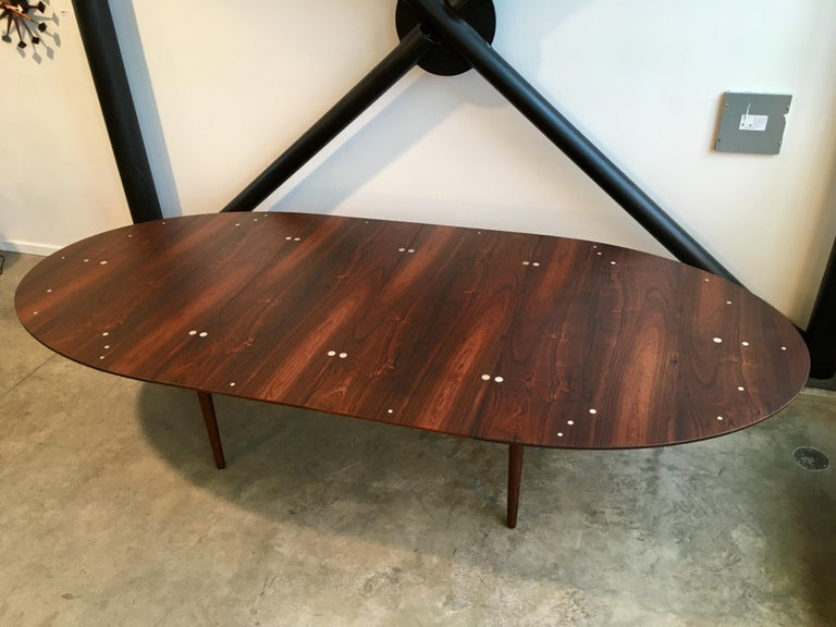 Authentic Judas table by Finn Juhl for Niels Vodder. This is the larger version in highly figured rosewood with silver plaquettes.   Excellent condition.