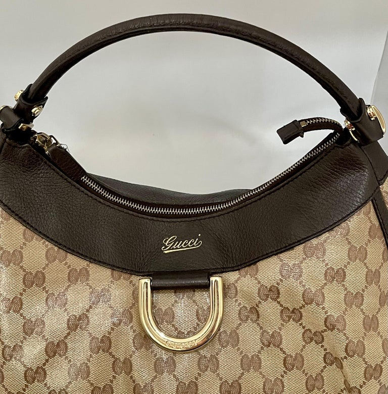 Authentic GUCCI Shoulder Hand Bag GG Canvas Leather Brown Beige PVC 2402051 Made in Italy Serial # 327786 213317 HS code 4202 22 4040 This is an authentic GUCCI Monogram authentic  Original Tote Tan . This chic tote is crafted of traditional brown