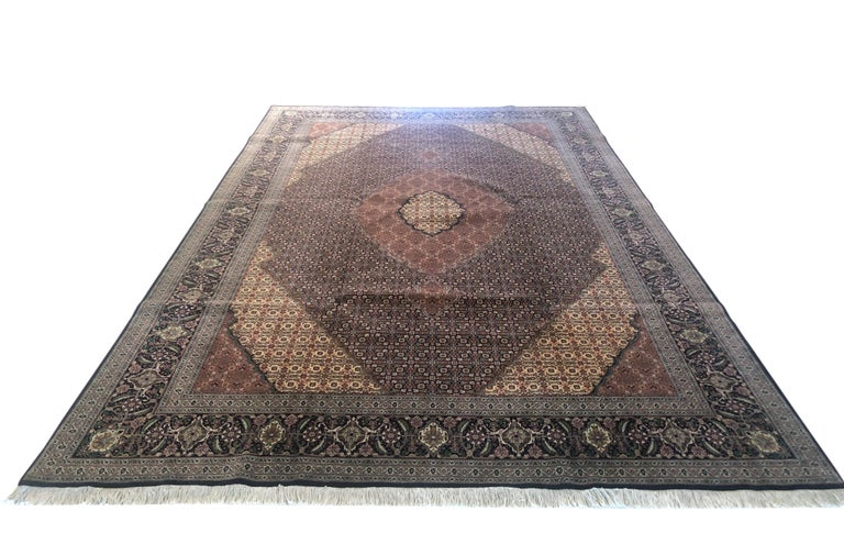 "Tabriz rugs are well known for their excellent weaving and design. One of the very famous patterns of Tabriz rugs are Fish Design known is Mahi. This beautiful piece has wool and silk pile with cotton foundation. This is an 1970s 50 ""RAJ"" consistent"