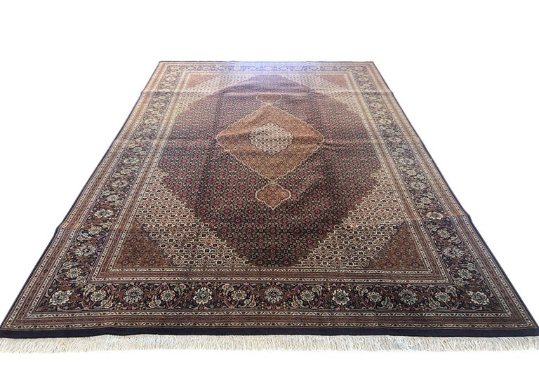 "Tabriz rugs are well known for their excellent weaving and design. One of the very famous patterns of Tabriz rugs are Fish Design known is Mahi. This beautiful piece has wool and silk pile with cotton foundation. This is an 1960s 50 ""RAJ"" consistent"