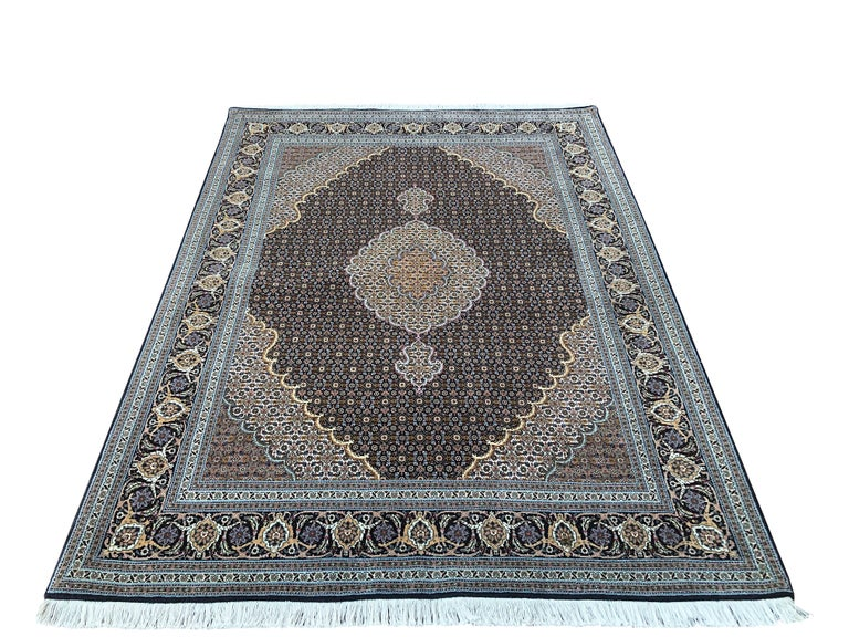 "Tabriz rugs are well known for their excellent weaving and design. One of the very famous patterns of Tabriz rugs are fish design known is Mahi. This beautiful piece has wool and silk pile with cotton foundation. This is an 2000s fine 50 ""RAJ"""