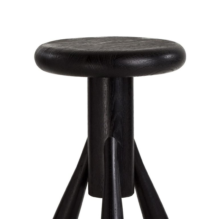 Authentic rocket bar stool in oak with black lacquer by Eero Aarino & Artek. Crafted in solid oak and originally created for Finnish designer Eero Aarnio's home kitchen, the bar stool has proved very popular since its introduction by Artek. Aarnio