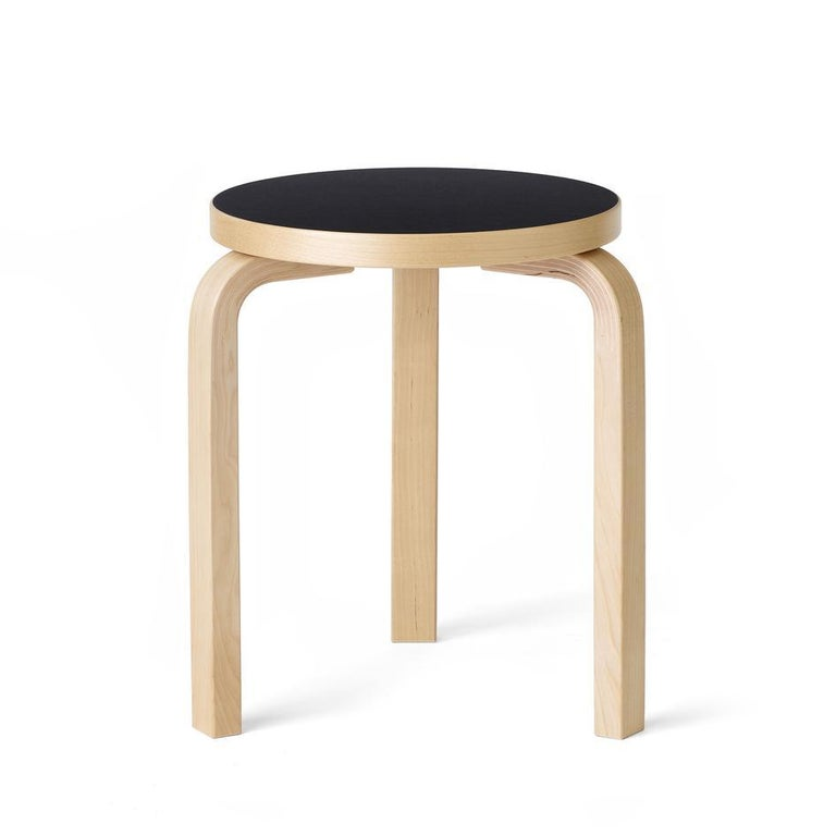 Authentic stool 60 in lacquered birch with Linoleum seat by Alvar Aalto & Artek. In the late 1920s, architect and designer Alvar Aalto began experimenting with bending wood. In collaboration with furniture manufacturer Otto Korhonen, the Finnish